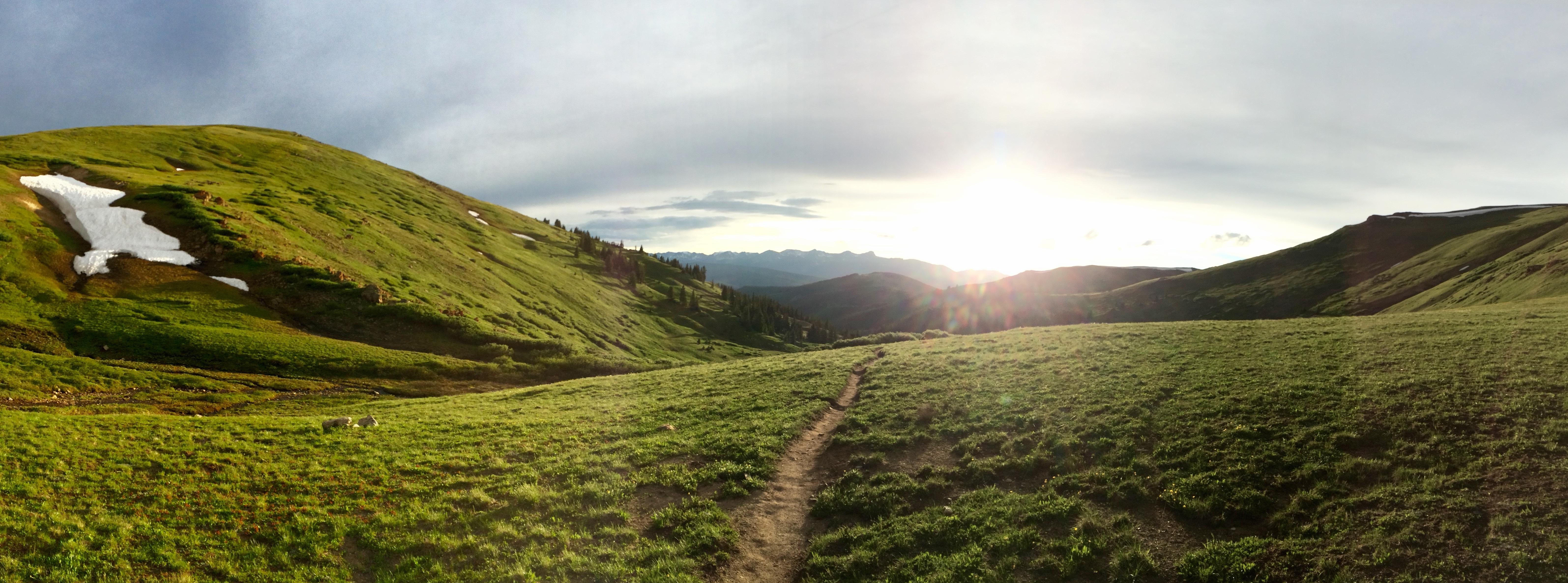mountain path with sun